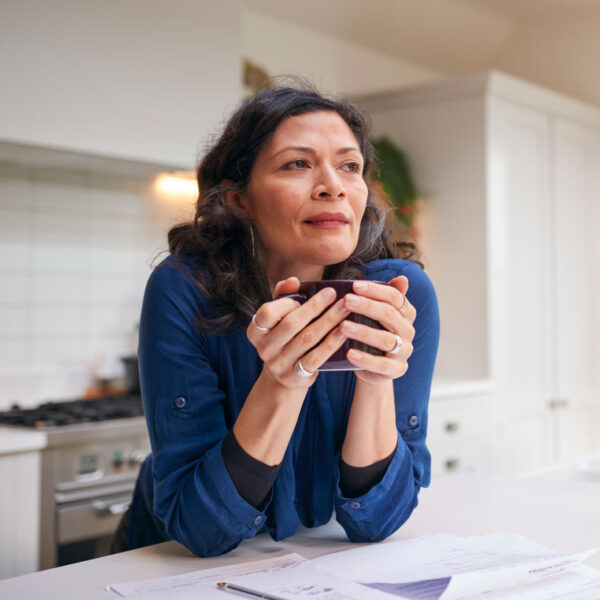 thoughtful-mature-woman-reviewing-domestic-finance-A3AR8YE